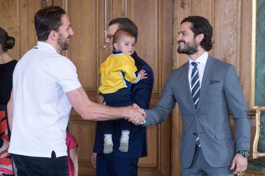 Les princes Daniel, Oscar et Carl Philip de Suède à Stockholm, le 22 mai 2017