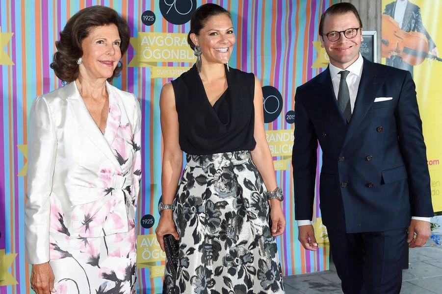 La reine Silvia et la princesse Victoria de Suède, avec le prince Daniel à Stockholm, le 21 août 2015