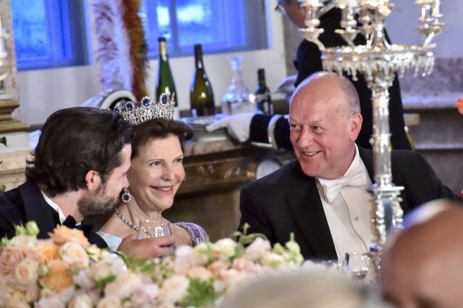 Le prince Carl Philip, la reine Silvia de Suède et Erik Hellqvist, le père de Sofia, le 13 juin 2015