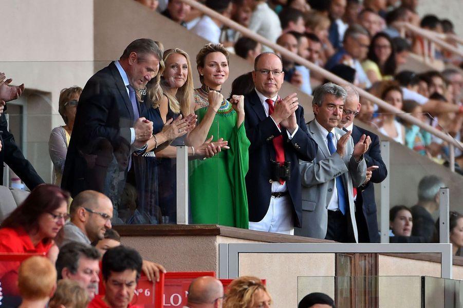 La princesse Charlène et le prince Albert II de Monaco premiers fans d'Usain Bolt.