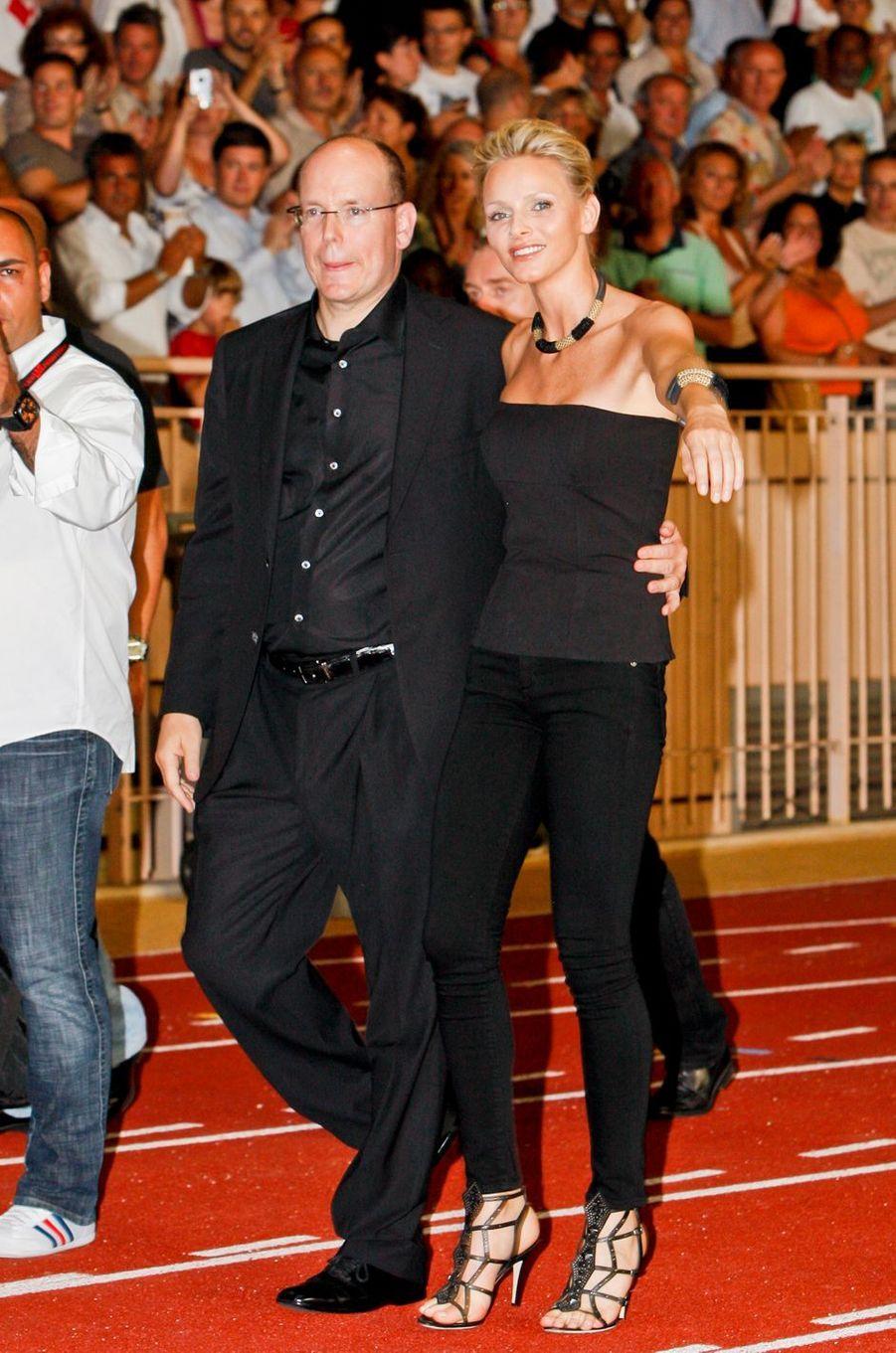 Charlène Wittstock et le prince Albert II de Monacoau stade Louis-II à Monaco pour le concert des Eagles, le 30 juin 2011