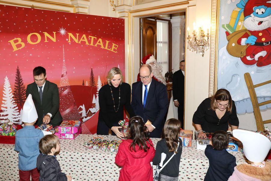 La princesse Charlène et le prince Albert II de Monaco avec Camille Gottlieb et Louis Ducruet à Monaco, le 18 décembre 2019
