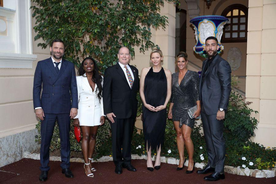 La princesse Charlène et le prince Albert II de Monaco avec Jeremy Sisto, Ebonee Noel, Missy Peregrym et Zeeko Zaki, à Monaco le 16 juin 2019