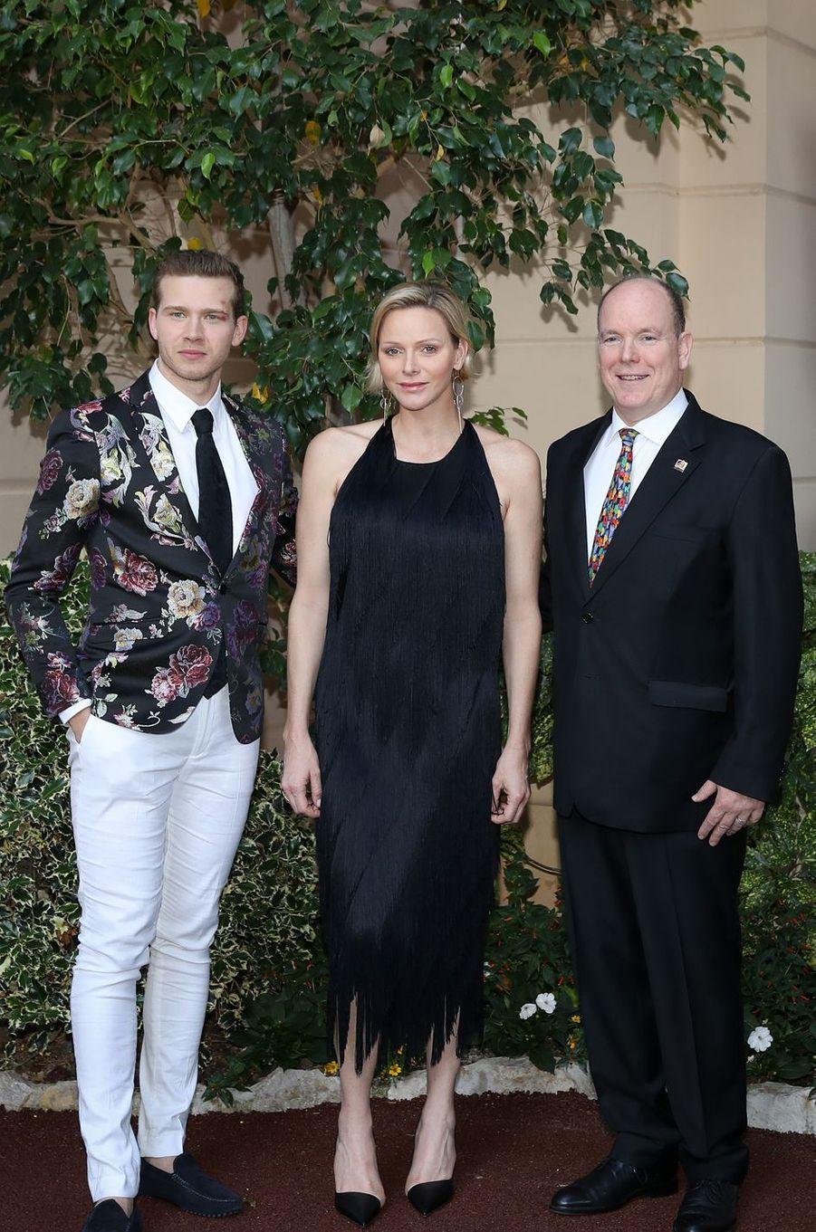 La princesse Charlène et le prince Albert II de Monaco avec Oliver Stark, à Monaco le 16 juin 2019