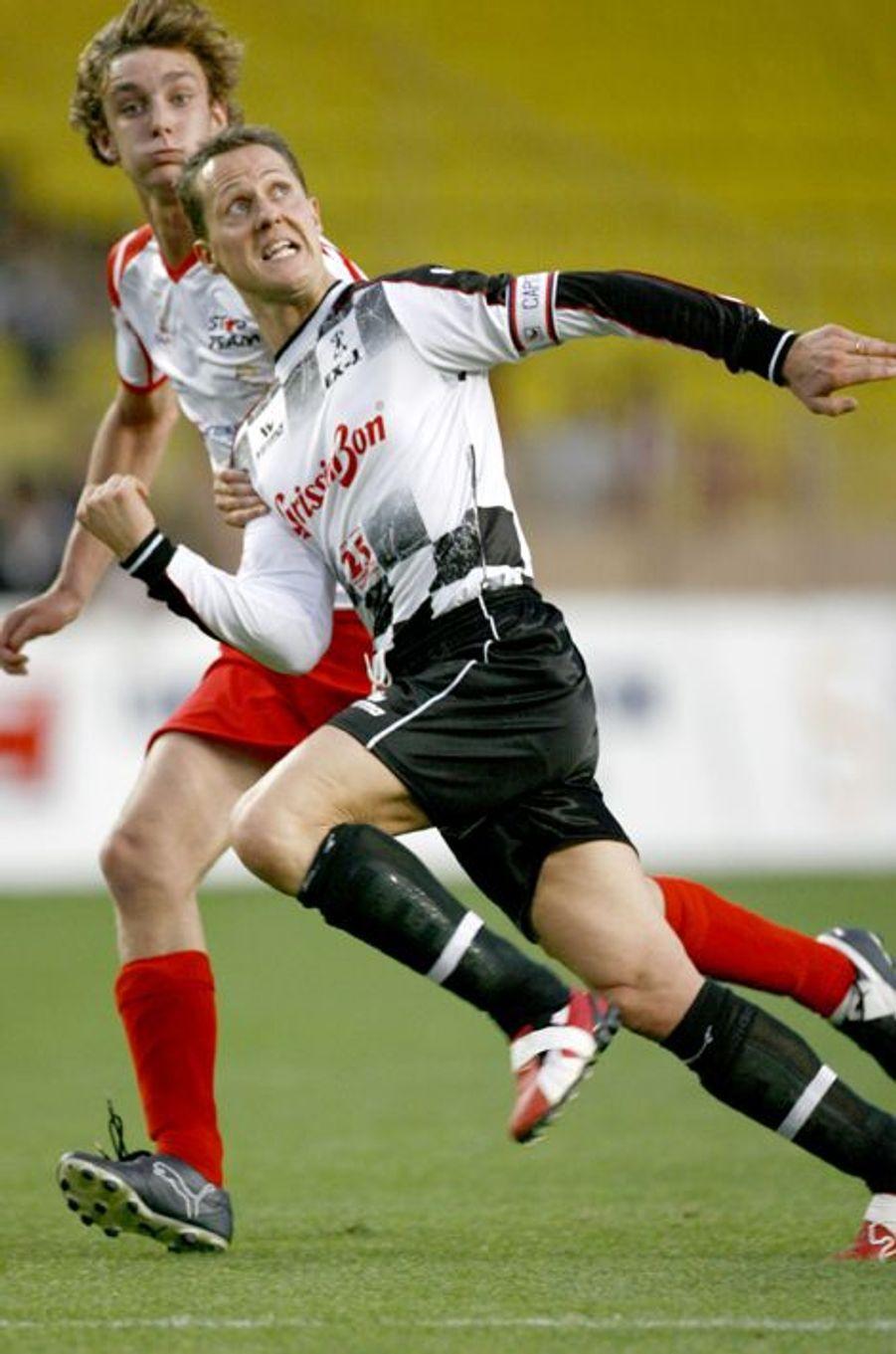 Lors de ce match gala, en 2006, il joue contre Michael Schumacher.