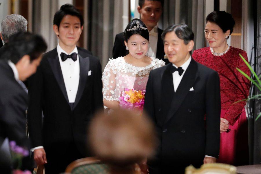 La princesse Massako et le prince Naruhito du Japon au banquet de mariage de la princesse Ayako et de Kei Moriya à Tokyo, le 30 octobre 2018