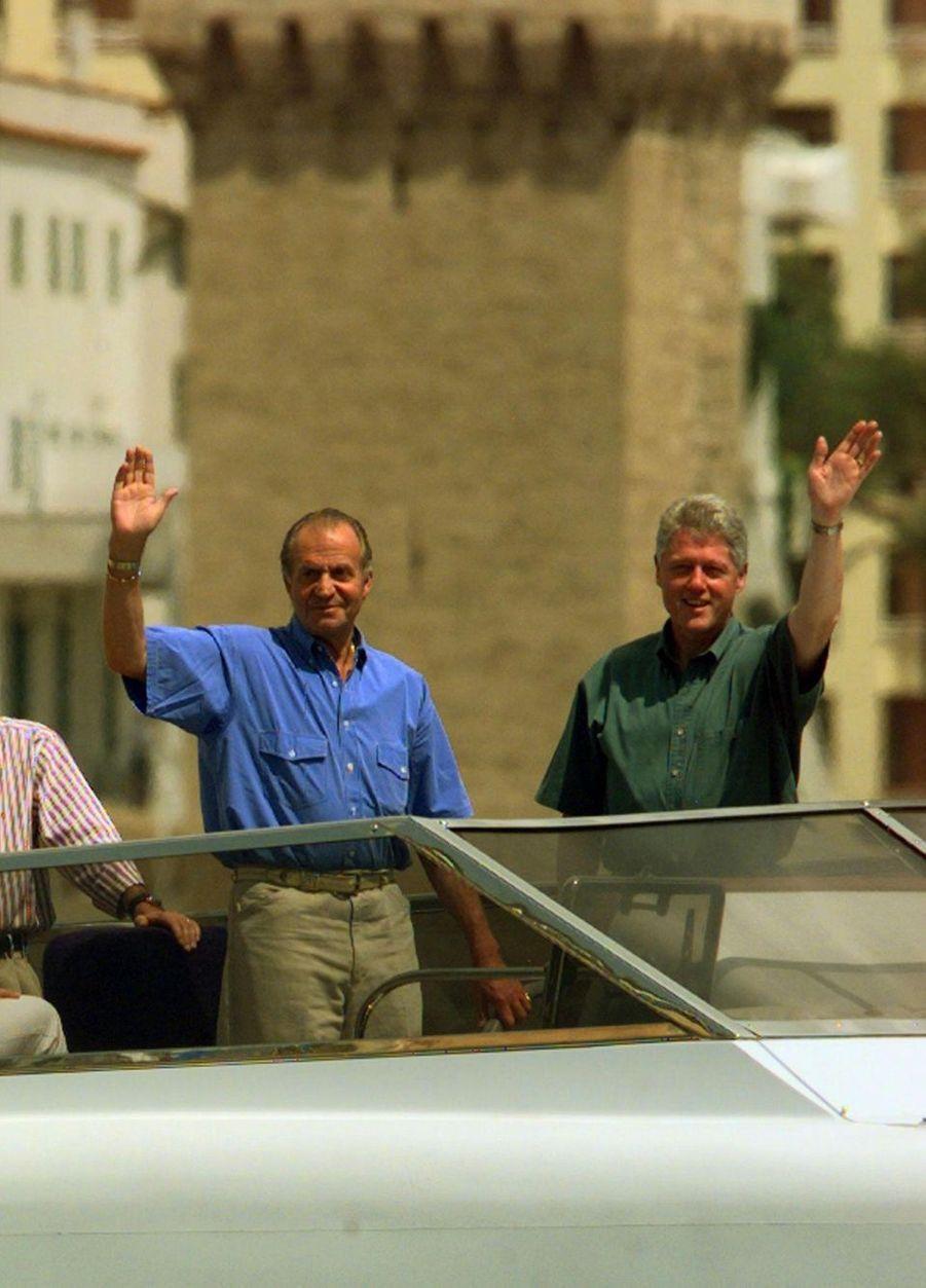 Juan Carlos et Bill Clinton sur le Fortuna en 1997.