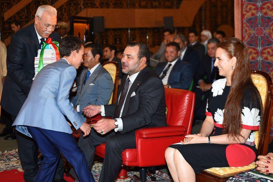 Le roi Mohammed VI et la princesse Lalla Salma avec le prince Moulay El Hassan à Rabat, le 16 juin 2015