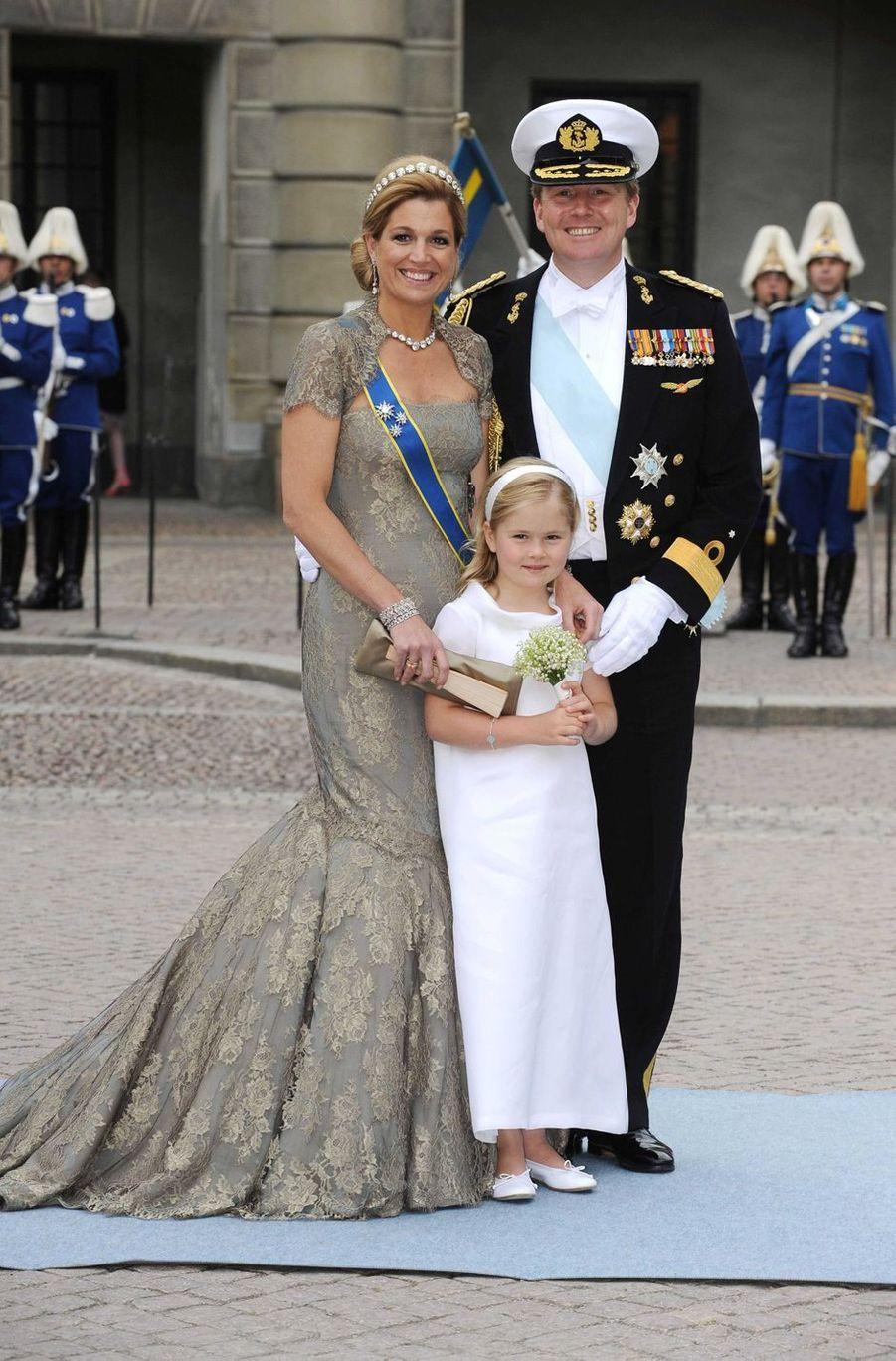 La princesse Catharina-Amalia des Pays-Bas avec ses parents la princesse Maxima et le prince héritier Willem-Alexander à Stockholm, le 19 juin 2010