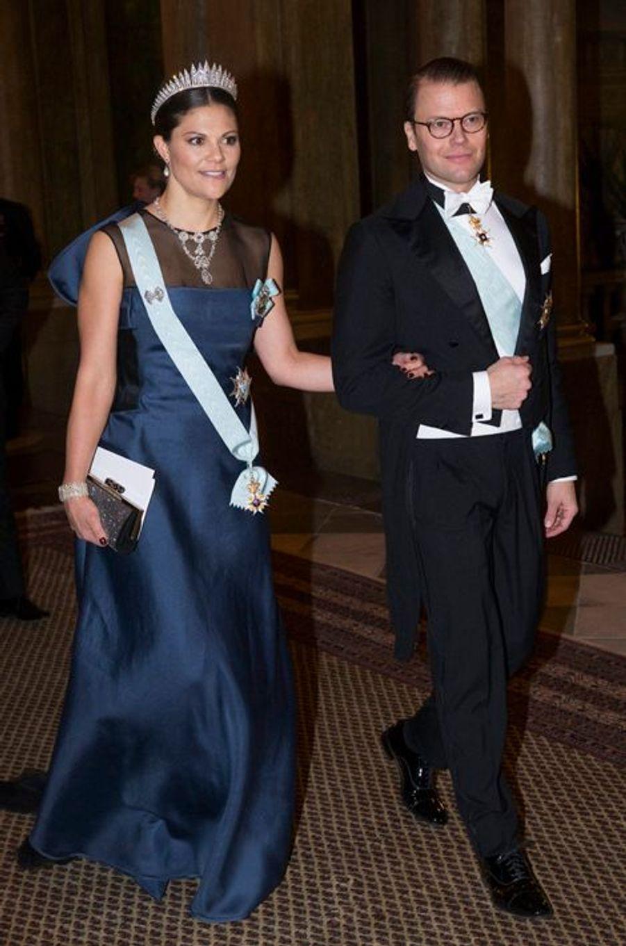 La princesse Victoria de Suède et le prince Daniel, son mari, au palais royal à Stockholm, le 11 décembre 2014