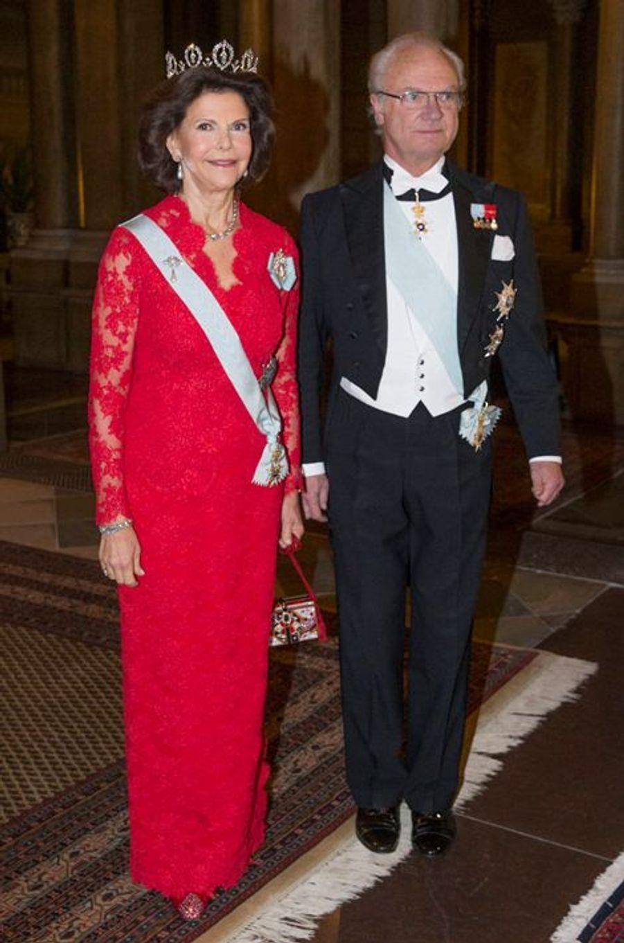 La reine Silvia et le roi Carl XVI Gustaf au palais royal à Stockholm, le 11 décembre 2014