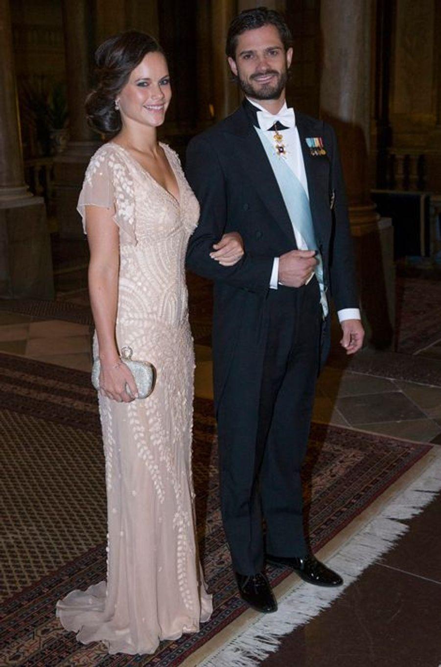 Sofia Hellqvist et le prince Carl Philip de Suède au palais royal à Stockholm, le 11 décembre 2014