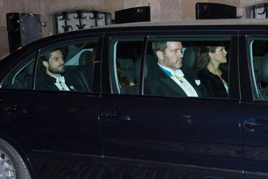 La princesse Madeleine et le prince Carl Philip de Suède, et Christopher O'Neill, à Stockholm, le 20 décembre 2014