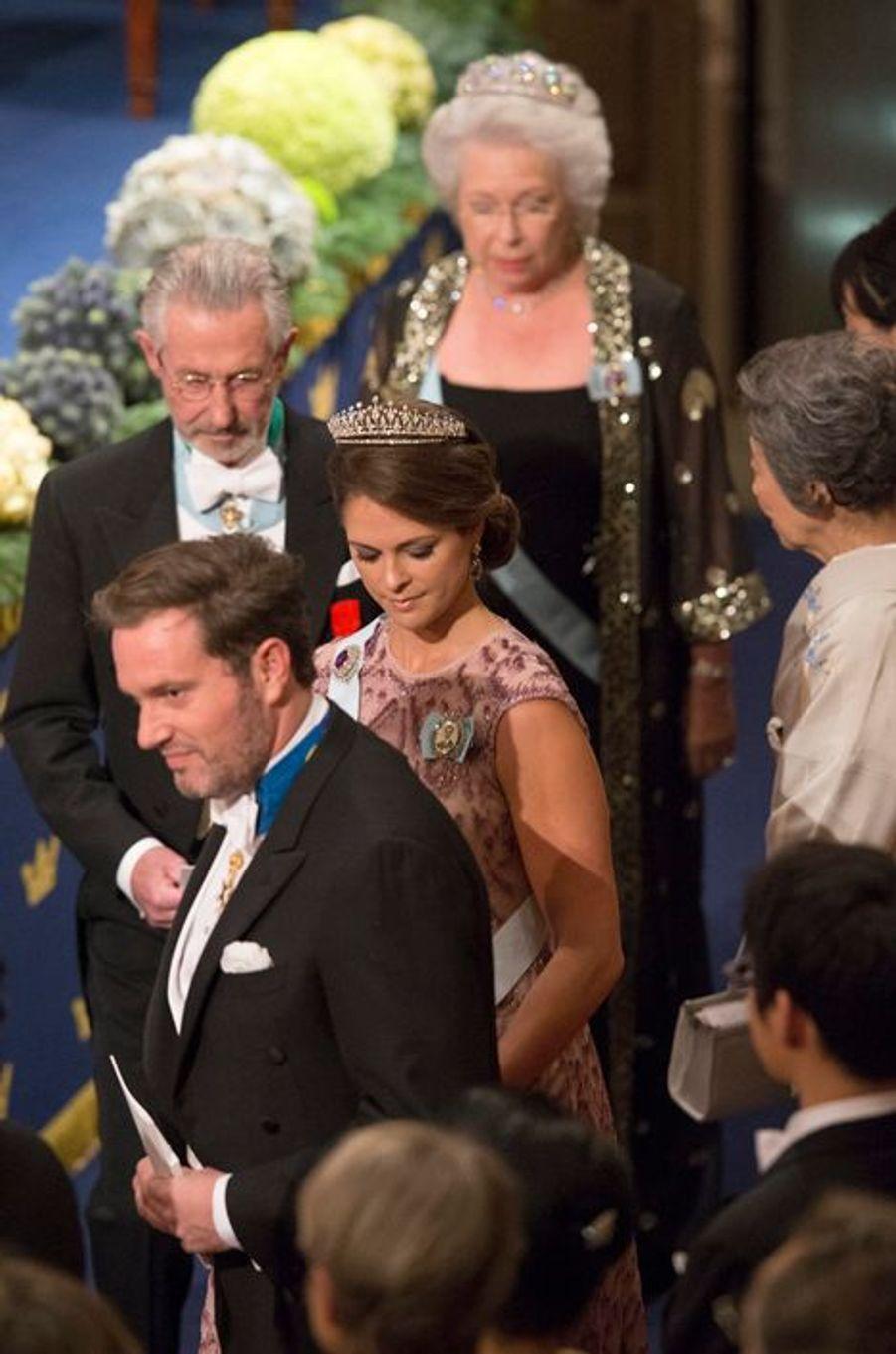 Les princesses Madeleine et Christina de Suède au banquet des prix Nobel à Stockholm, le 10 décembre 2014