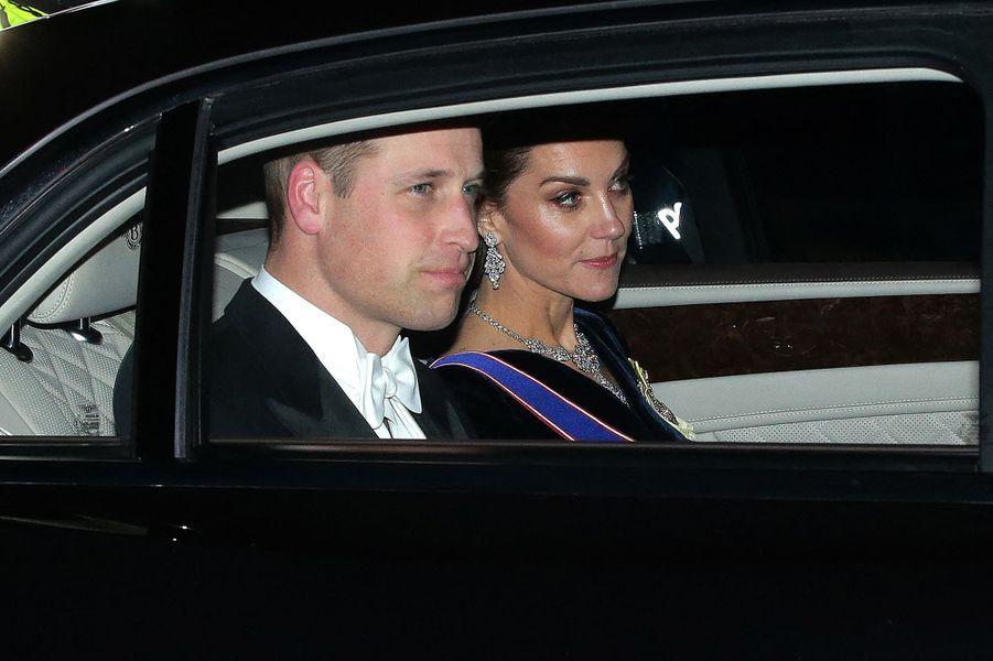 Kate Middleton et le prince William se rendent à Buckingham Palace pour la réception organisée par la reine pour le corps diplomatique, à Londres le 11 décembre 2019