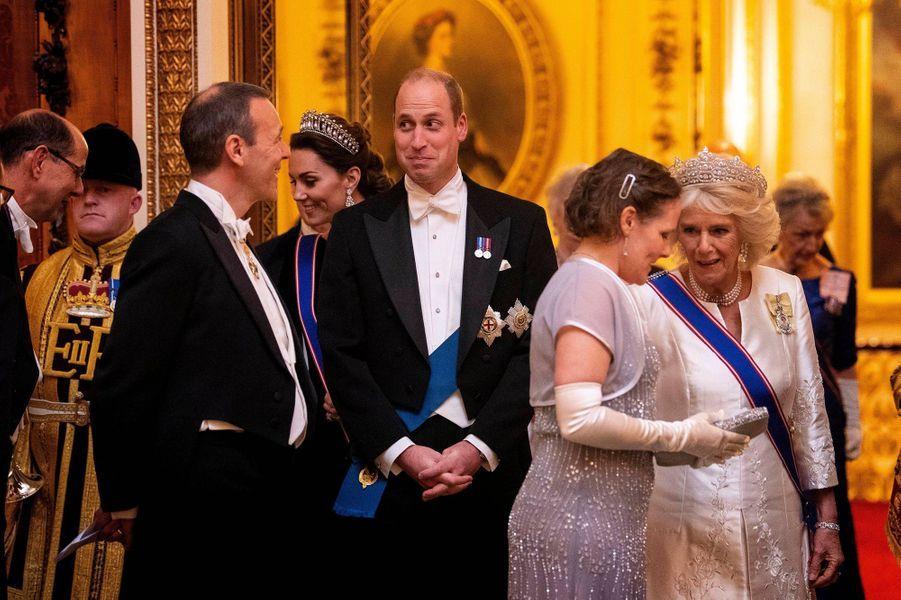 Kate Middleton, le prince William et la duchesse de Cornouailles Camilla à Buckingham Palace pour la réception organisée par la reine pour le corps diplomatique, à Londres le 11 décembre 2019