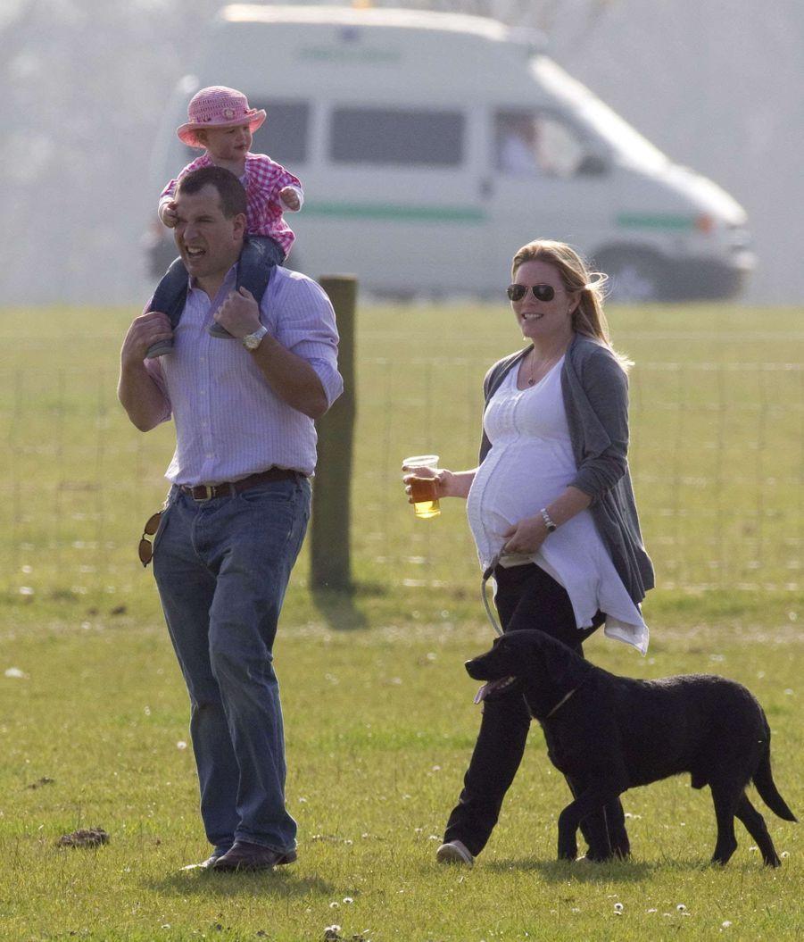 Peter Phillips et Autumn, enceinte d'Isla, avec leur fille Savannah, le 24 mars 2012