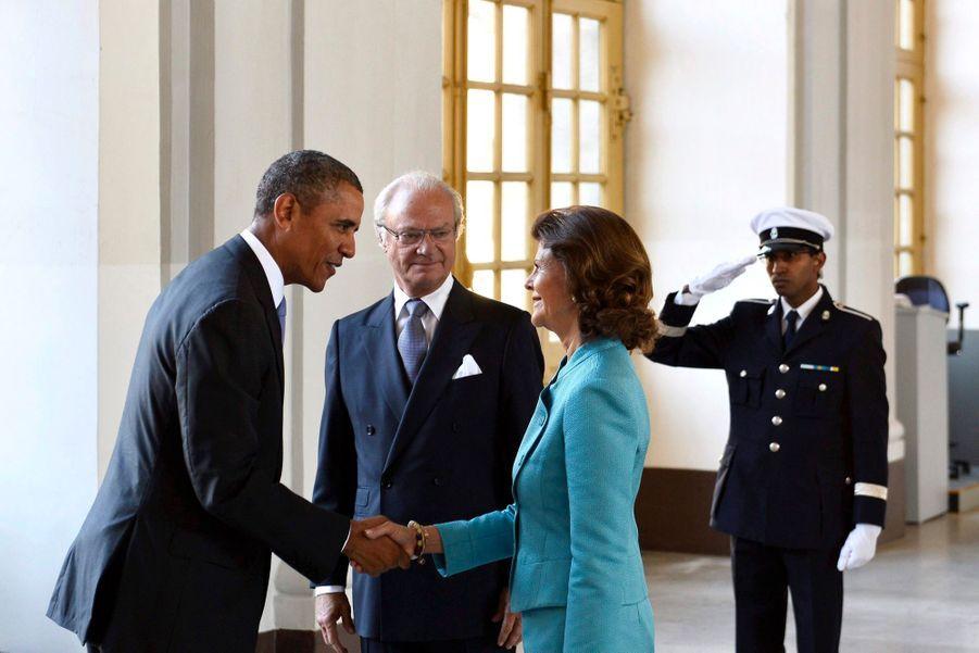 Barack Obama avec le roi Carl XVI Gustaf de Suède et son épouse la reine Silvia, à Stockholm en septembre 2013.