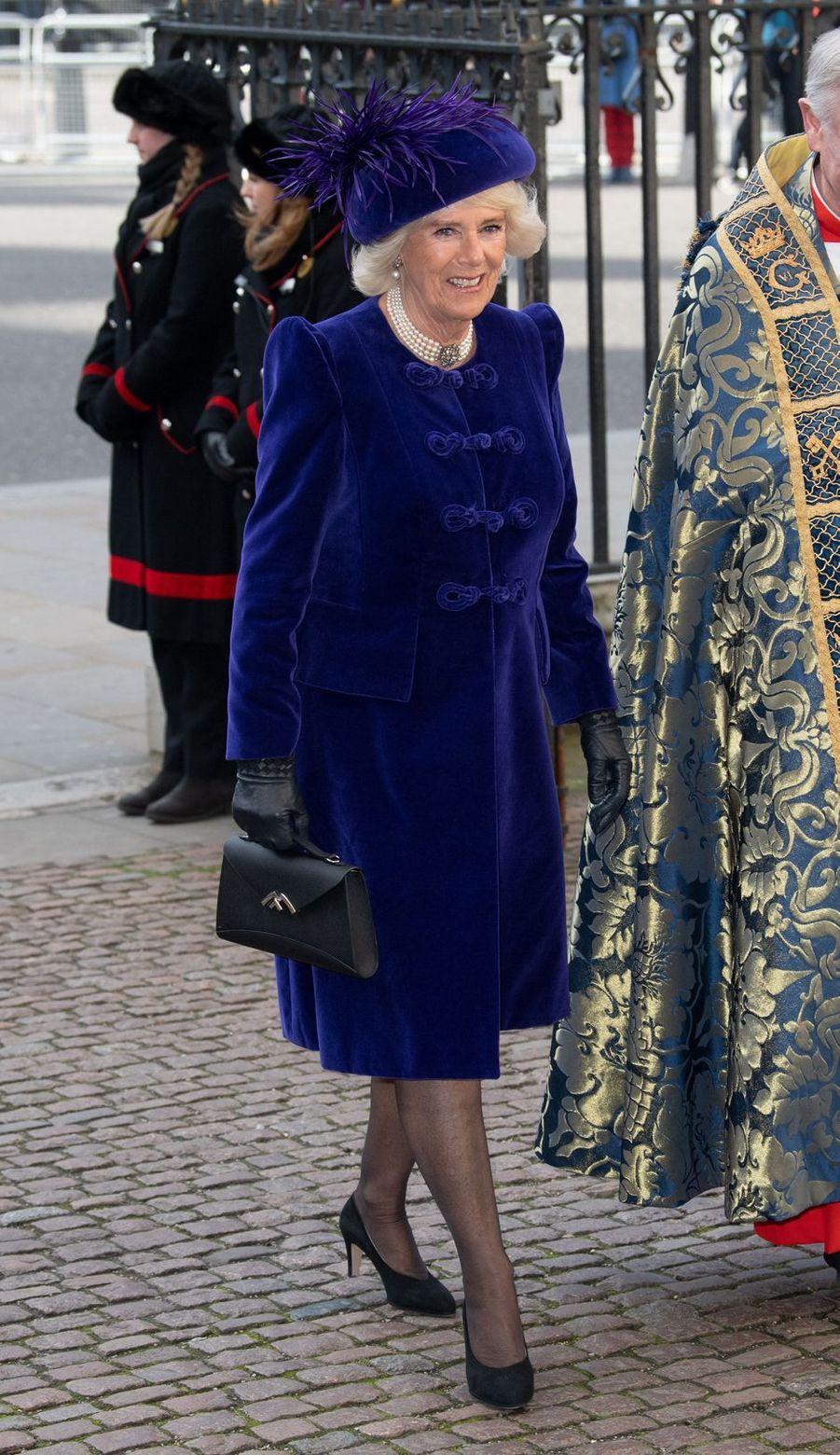 La duchesse de Cornouailles Camilla en violet à Londres, le 11 mars 2019