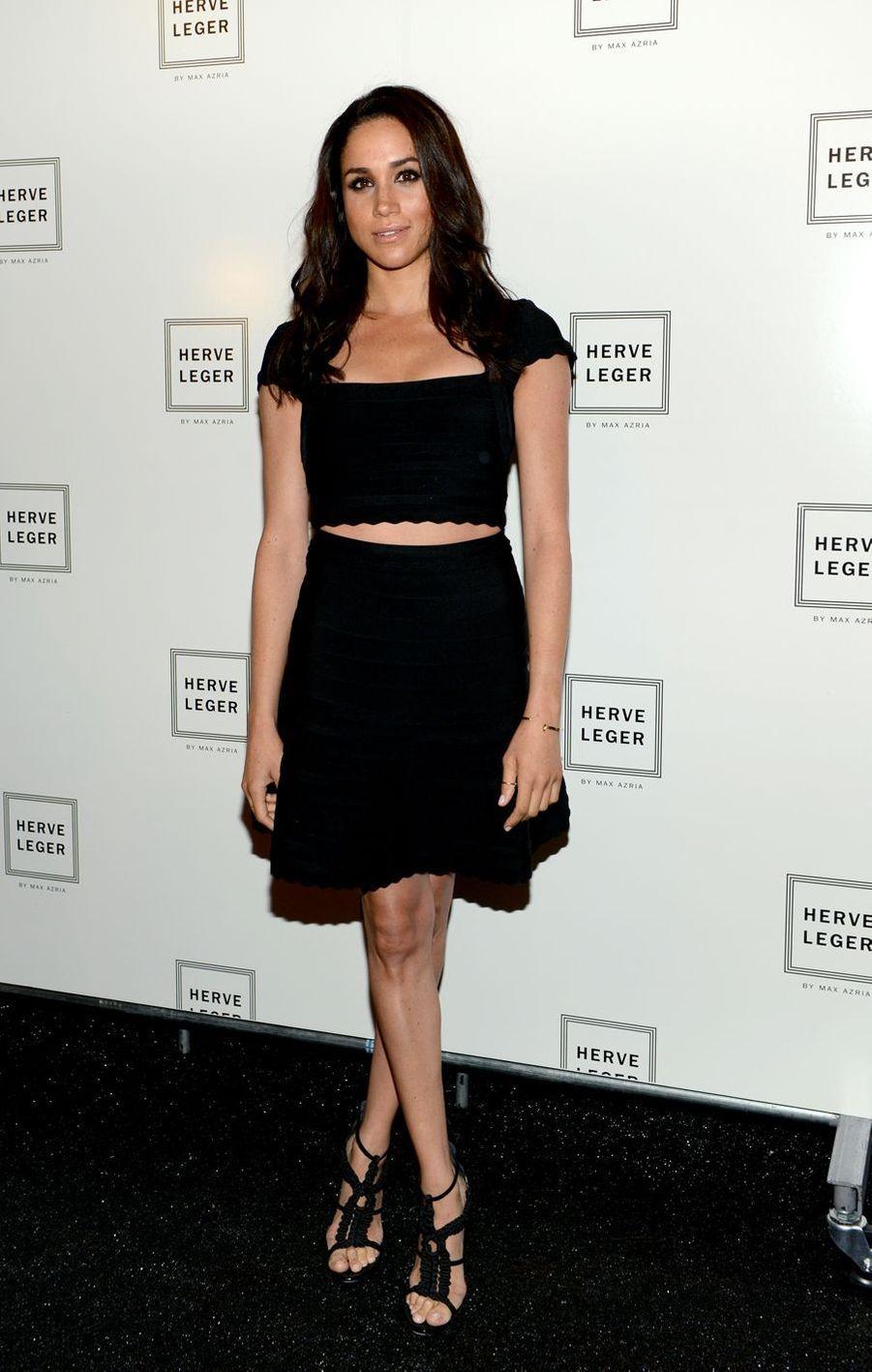 Meghan Markle lors du défilé Hervé Léger à la Fashion Week de New York en septembre 2013.