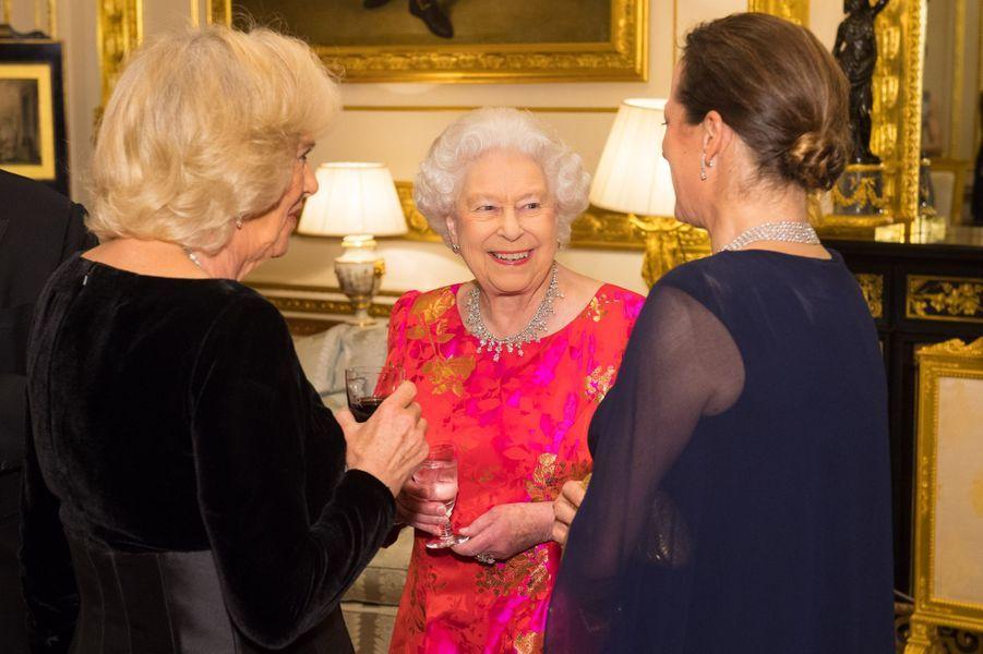 La reine Elizabeth II avec la duchesse de Cornouailles Camilla et la princesse Zahra Aga Khan à Windsor, le 8 mars 2018
