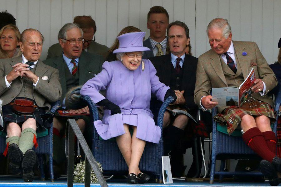 La reine Elizabeth II avec les prince Philip et Charles à Braemar, le 3 septembre 2016