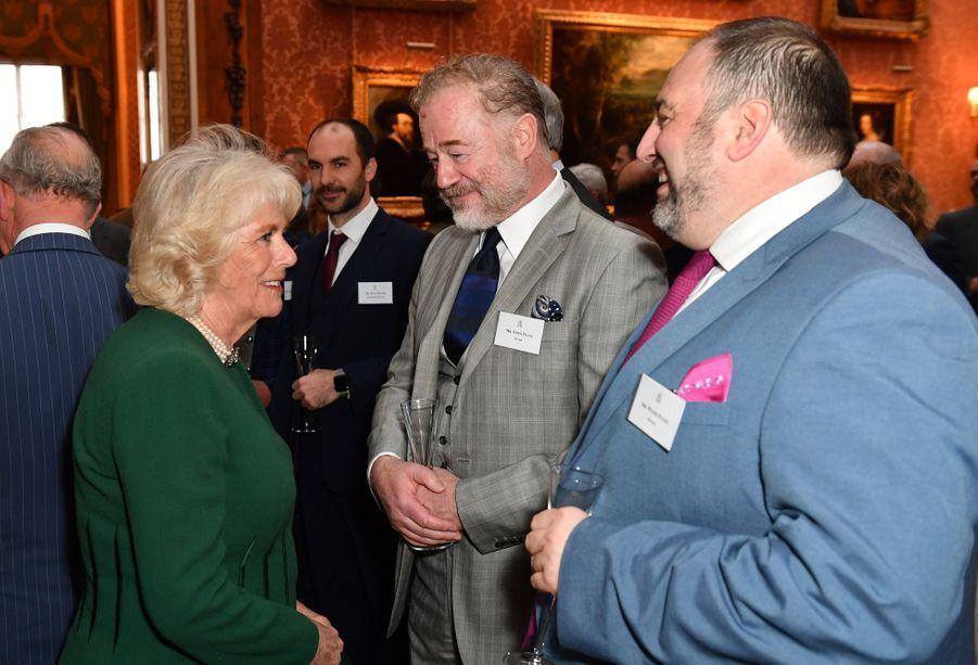 Camilla Parker Bowlesà la réception tenuepour les 50 ans de l'investiture du prince de Galles au palais de Buckingham le 5 mars 2019