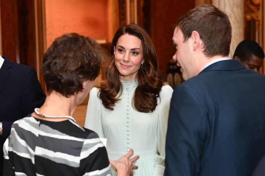 Kate Middletonà la réception tenuepour les 50 ans de l'investiture du prince de Galles au palais de Buckingham le 5 mars 2019