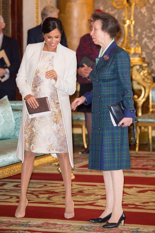 Meghan Markle et la princesse Anneà la réception tenuepour les 50 ans de l'investiture du prince de Galles au palais de Buckingham le 5 mars 2019
