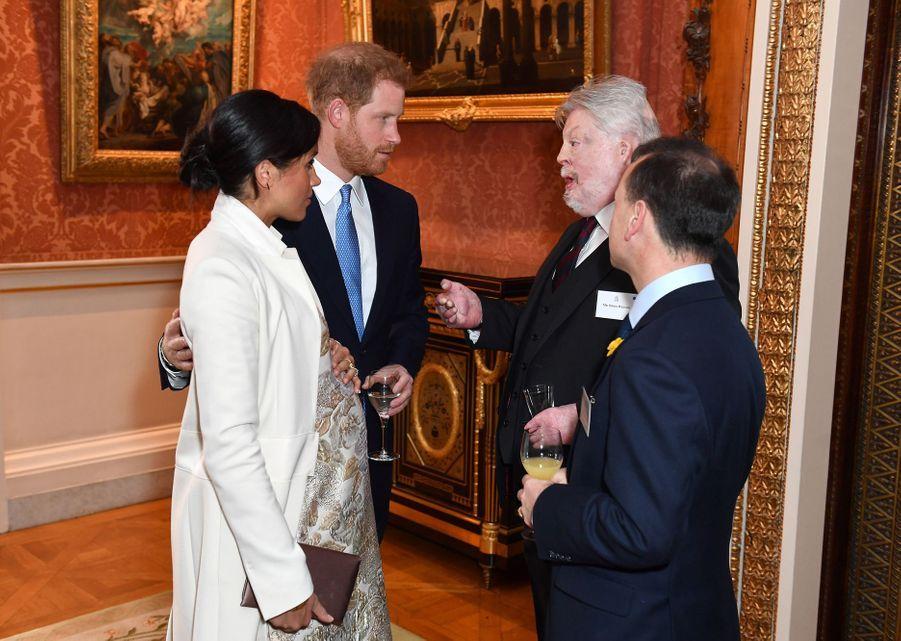 Meghan Markle, le prince Harry,Simon Weston et Alun Cairns à la réception tenuepour les 50 ans de l'investiture du prince de Galles au palais de Buckingham le 5 mars 2019