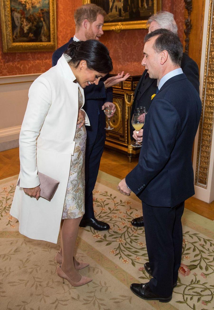 Meghan Markle, le prince Harry,Simon Weston et Alun Cairnsà la réception tenuepour les 50 ans de l'investiture du prince de Galles au palais de Buckingham le 5 mars 2019