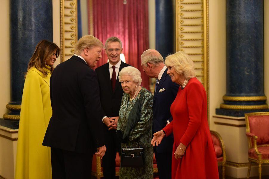 Donald et Melania Trump rencontrent la reine Elizabeth II, le prince Charles et sa femme Camillaà Buckingham Palace lors du70ème anniversaire du Sommet de l'OTANà Londres le 3 décembre 2019