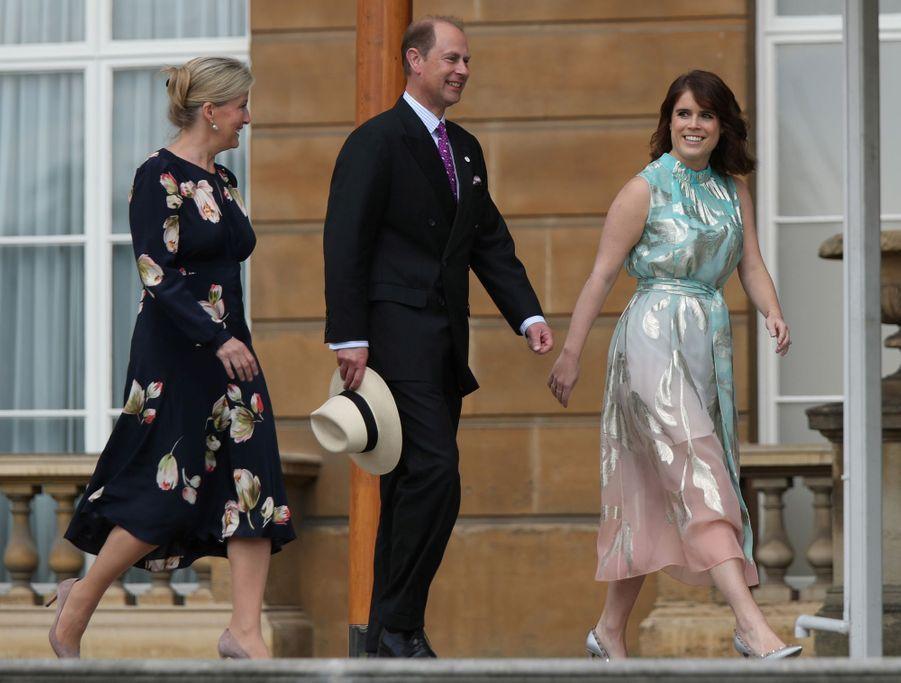 La princesse Eugenie d'York avec la comtesse Sophie de Wessex et le prince Edward à Londres, le 22 mai 2019