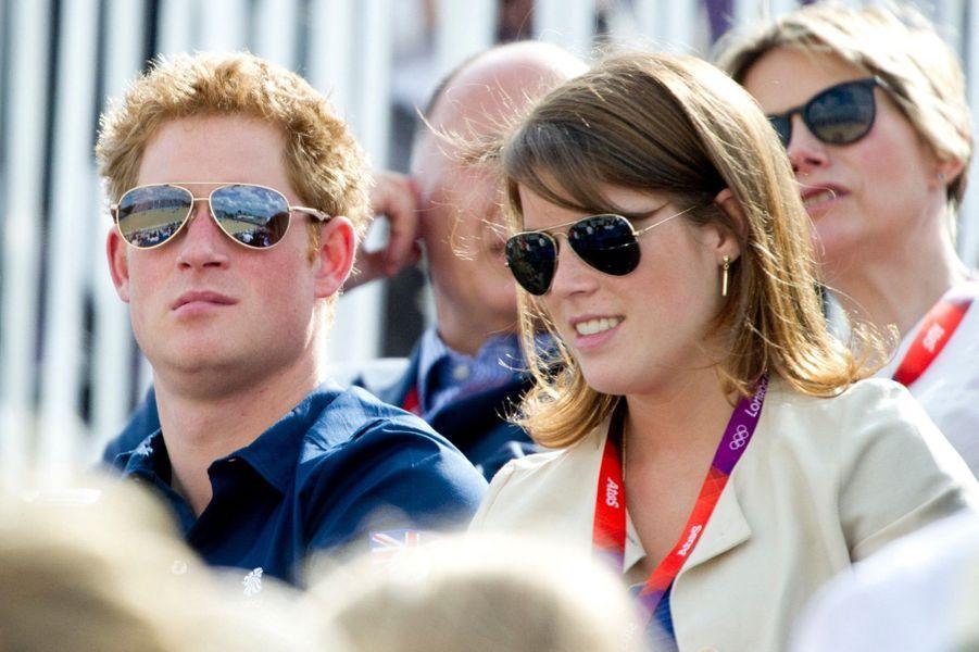 Le prince Harry et la princesse Eugenie assistent aux Jeux Olympiques de Londres en 2012.