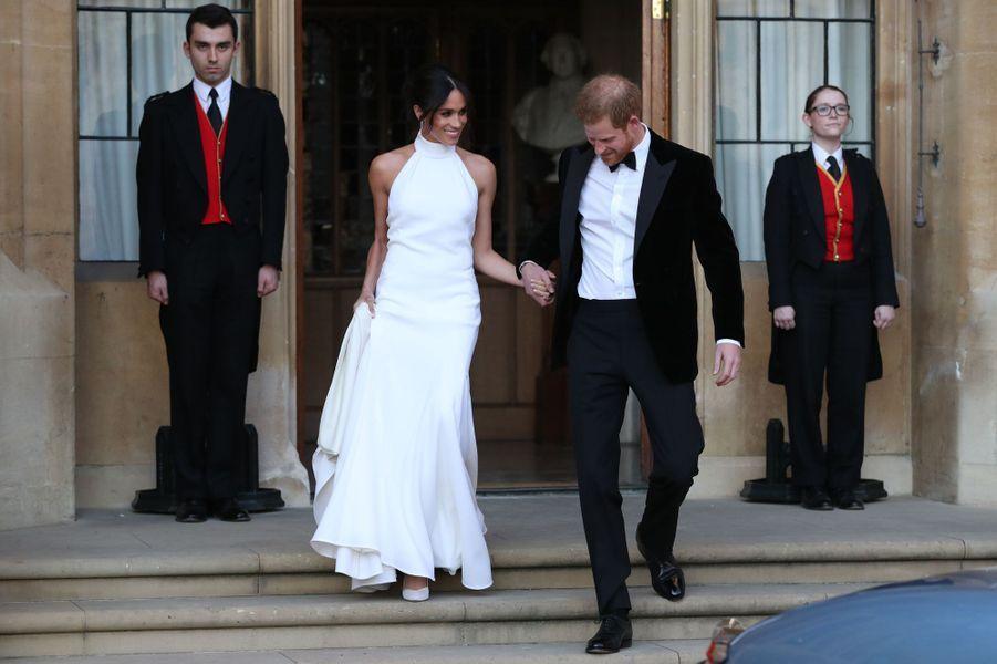 Meghan Markle, dans une robe Stella McCartney, et le prince Harry, le jour de leur mariage, le 19 mai 2018