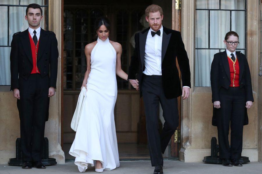 Meghan Markle, dans une robe du soir Stella McCartney, et le prince Harry, le jour de leur mariage, le 19 mai 2018