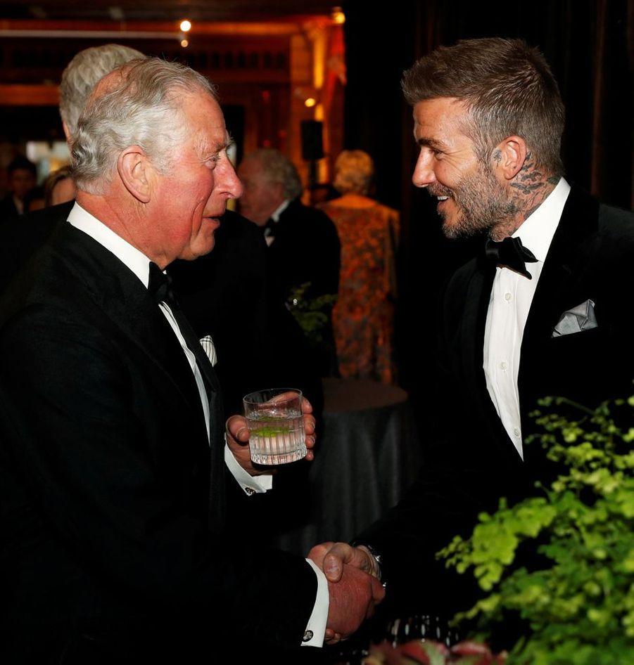 Le prince Charles avec David Beckham à Londres, le 4 avril 2019