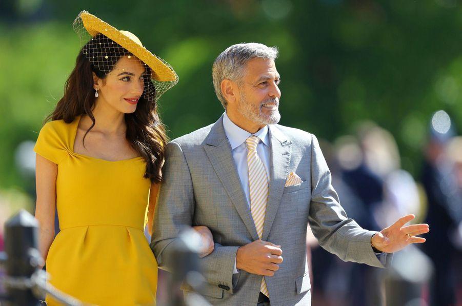 Amala et George Clooneyau mariage de Meghan et Harry