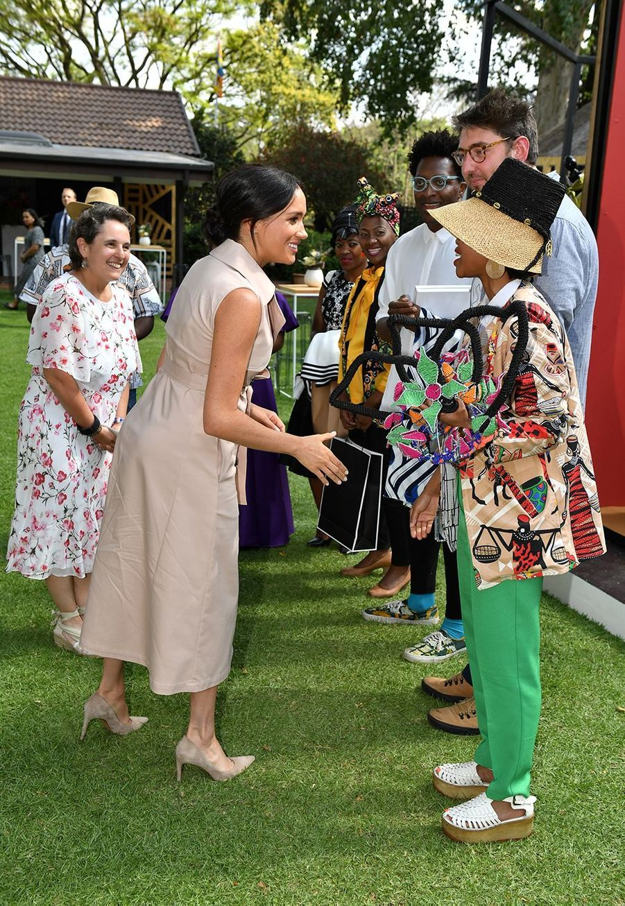 Meghan Markle à la réception organisée àla résidence du Haut-commissaire de Grande-Bretagne en Afrique du Sud àJohannesburg le 2 octobre 2019