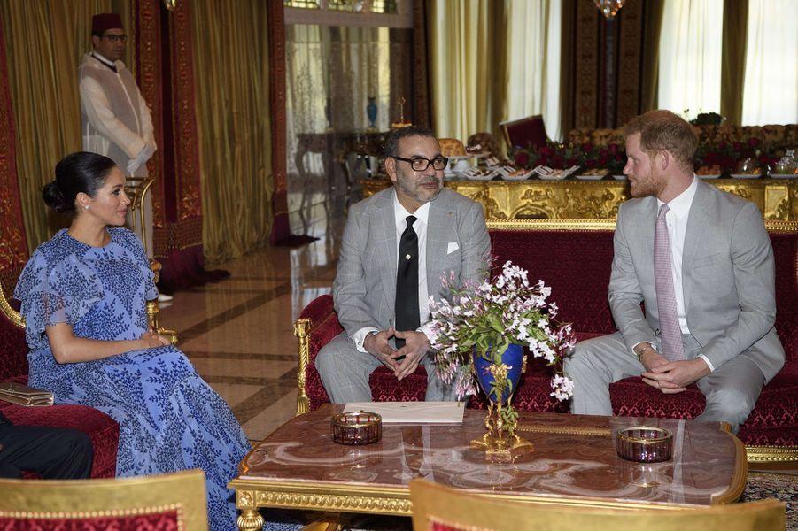Meghan Markle enceinte et le prince Harry rencontrent le roiMohammed VI à Rabat le 26 février 2019.