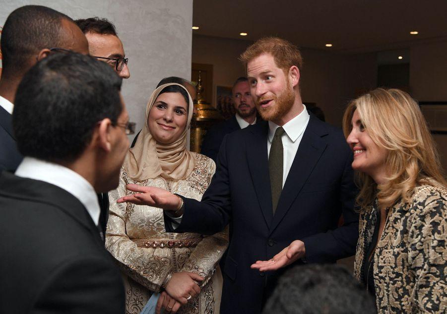 Le prince Harry assiste à une réception organisée par l'ambassadeur britannique au Maroc, Thomas Reilly, à la résidence britannique de Rabat, le 24 février 2019