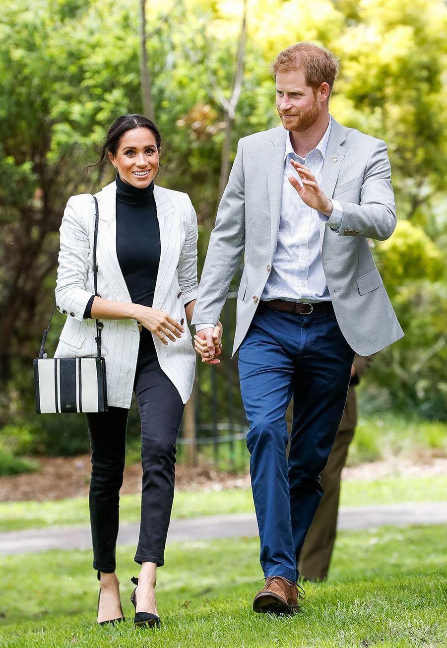 """Le duc et la duchesse de Sussex lors des """"Invictus Games"""" à Sydney, le 21 octobre 2018."""