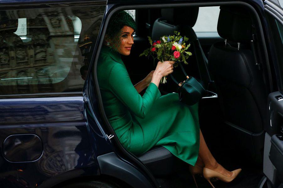 Meghan Markle, dans une robe verte de la marque Emilia Wickstead,et le prince Harry se rendentà la traditionnelle messe célébrée à l'occasion de la journée du Commonwealth à Westminster Abbey à Londres le 9 mars 2020.