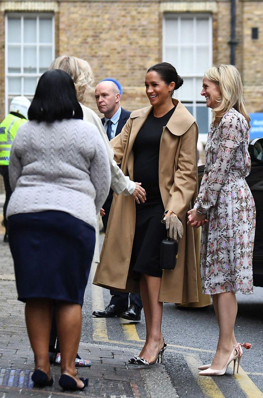 Meghan Markle, duchesse de Sussex, dans un manteau Oscar de la Renta, à Londres le 10 janvier 2019