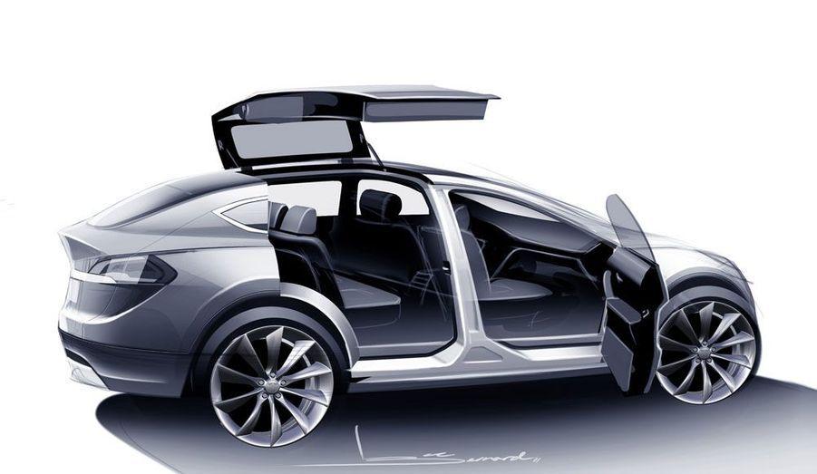 Tesla promet un habitacle ultra-moderne, avec un pare-brise panoramique et un écran tactile dominant la console centrale.