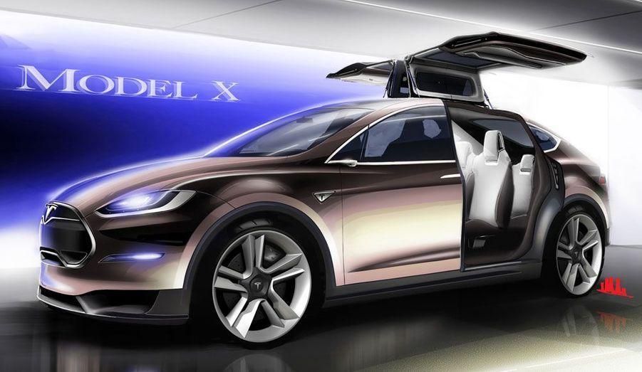 Première sur un SUV, le Model X sera doté de portes papillon, comme la Mercedes SLS AMG.