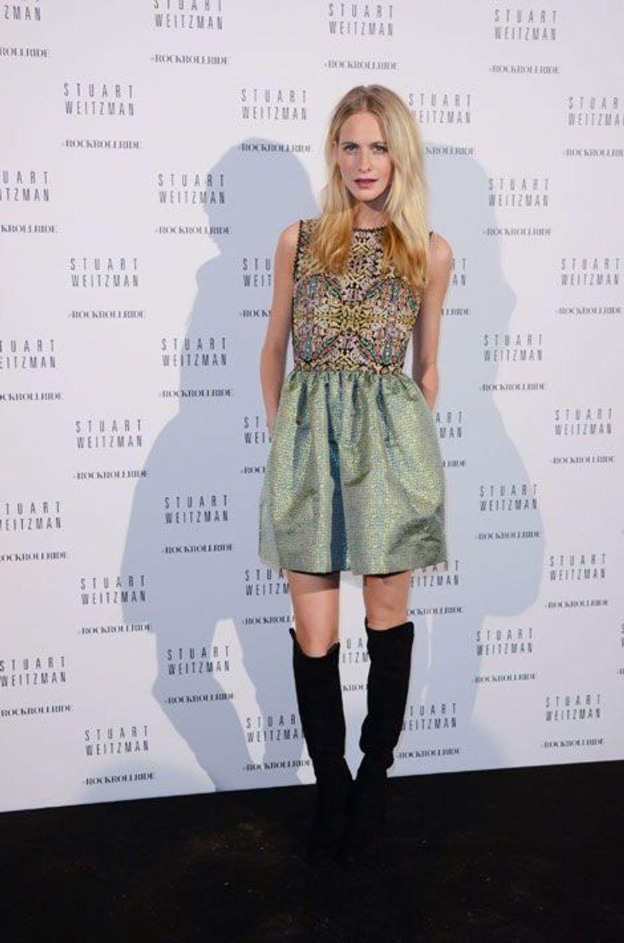 L'ancien mannequin Poppy Delevingne lors de la soirée organisée par la marque de chaussures Stuart Weitzman à Paris, le 28 septembre 2014