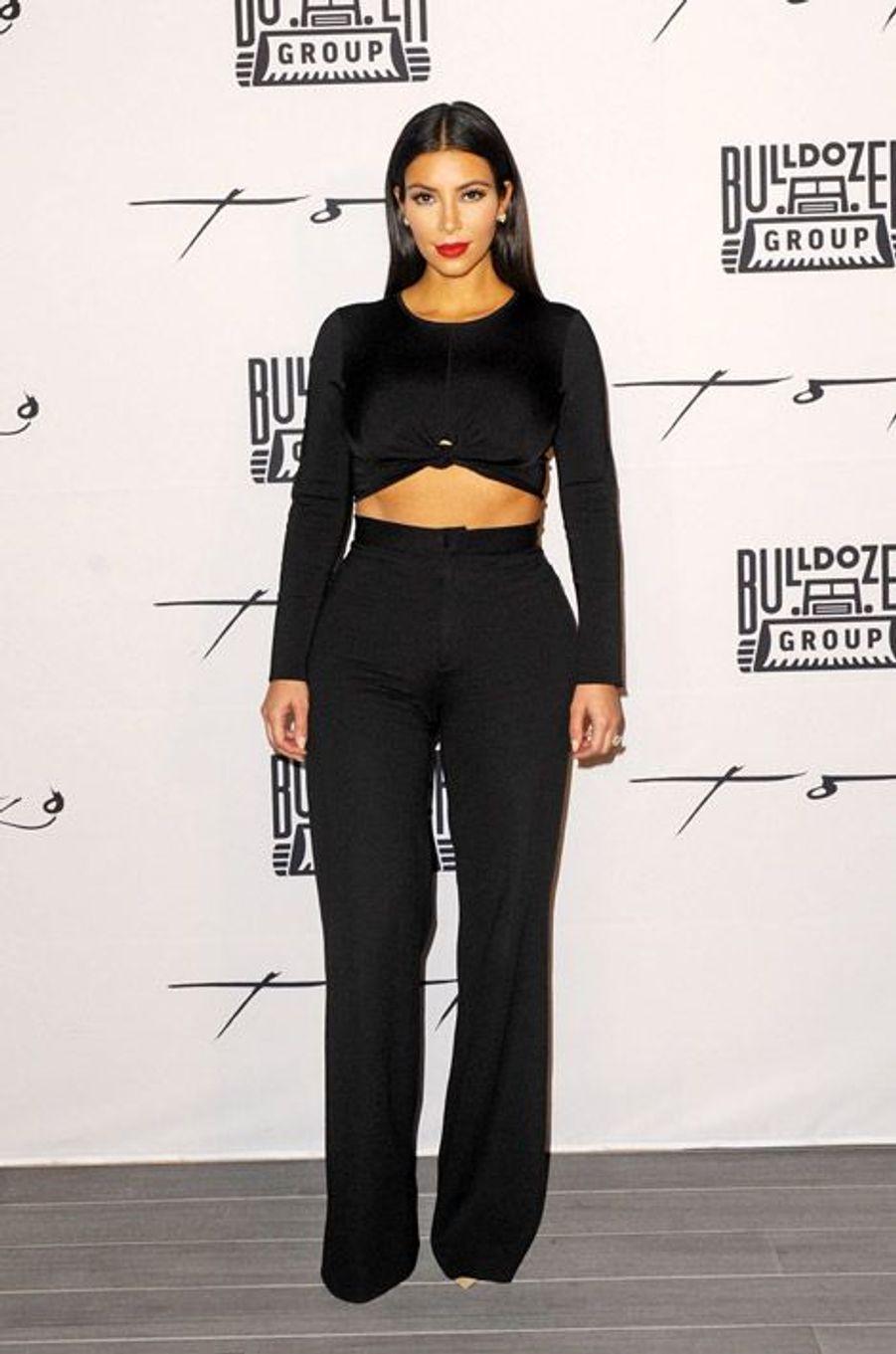La star de la télérélité américaine Kim Kardashian en Balmain et Alexander McQueen pour un dîner de charité à Dubaï, le 24 novembre 2014