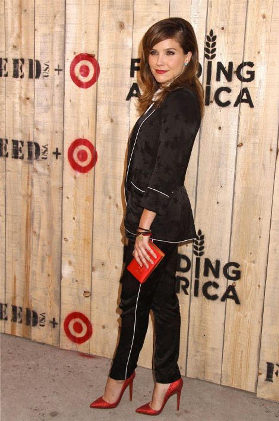 "En smoking pour un gala de charité ""Feed USA"" à New York, en juin 2013"