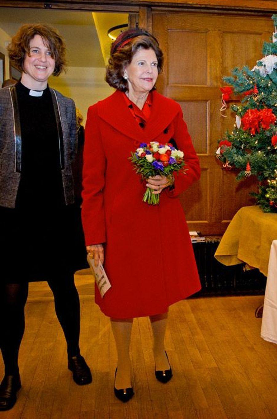 La reine Silvia de Suède en visite à Paris, le 2 décembre 2014